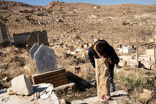 22/02/2017 - Khana Sor, Iraq: Jalal Haskany visits the grave of his uncle who lost his life while he tried to pass the Aegan Sea from Turkey to Greece in a boat. The Yazidi people have their own graveyards of their tribe where the deceased get buried.