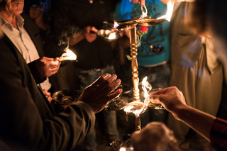 18/04/2017 - Lalish, Iraq: With the fire, visitors light their candlewicks which they soaked in wax and oil and recite prayers after that. Fire is an important part of their belief and they have been attacked and persecuted for that since ever.